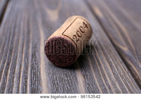 Wine cork on wooden table close-up