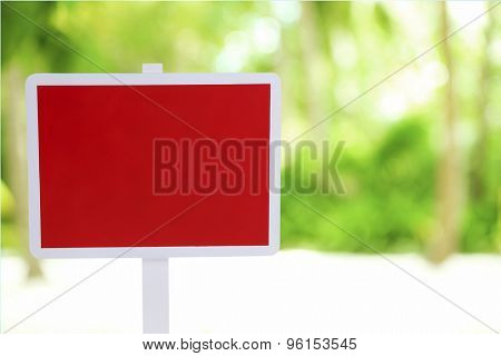 Wooden sign board on nature background
