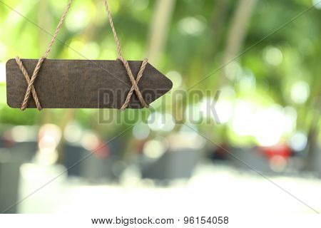 Wooden sign arrow on nature background