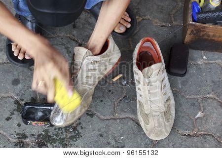 A Man Repairing A Shoe