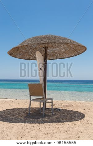 Beach Umbrella With Chair On Beach