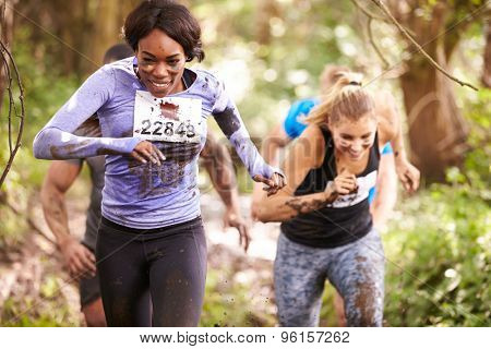 Two women enjoying a run in a forest at an endurance event