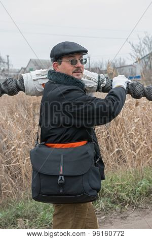 Man Is Carrying Roll Mesh Netting On His Shoulder.