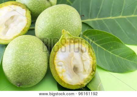 Young Raw Green Nuts On Green Background