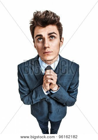Young Businessman Praying