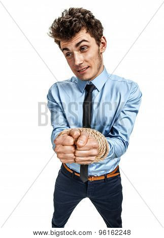 Handsome Businessman's Hands Tied Together With Rope, Modern Slavery Concept