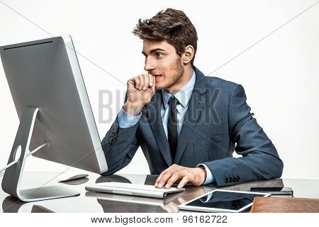 Entrepreneur Looking At Computer Screen With Horror