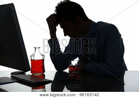 Silhouette Of Sad And Depressed Young Man In Alcohol Addiction
