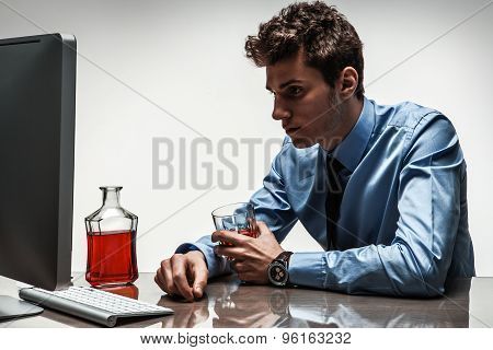 Drunk Man Sitting Drunk At Office Holding Glass