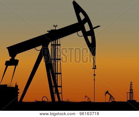 Vector image of oil derricks on the ground