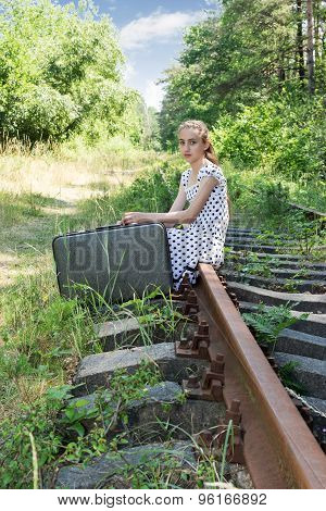 Young Traveling Girl Sitting On Rail