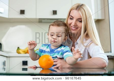 Cheerful young mother with her small son