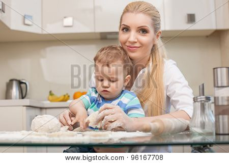 Cute family are baking tasty cookies in the kitchen