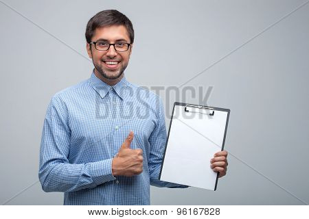 Attractive young male manager with positive emotions