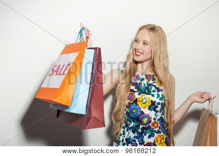 Cheerful young woman is happy about her purchasing