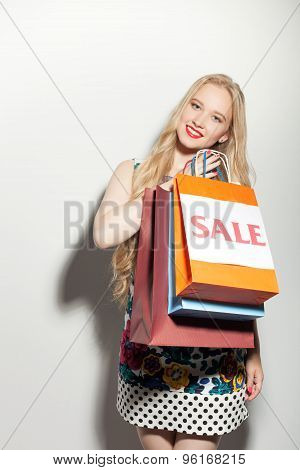 Attractive young girl is presenting her purchase