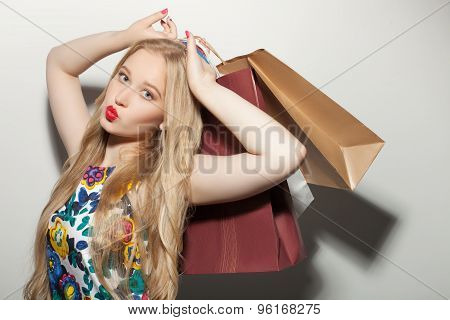 Beautiful young healthy girl loves do shopping