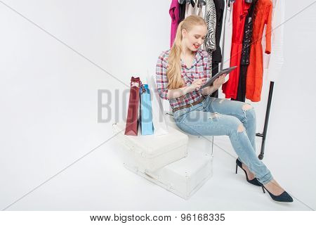 Beautiful young girl is wasting time in boutique