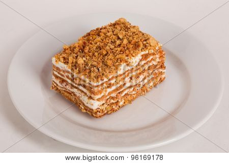 honey cake on a plate white background for cafe menu