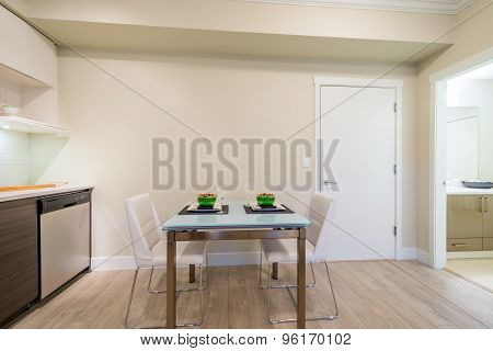 Dining table set for two in a modern kitchen. Interior design.