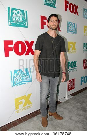SAN DIEGO, CA - JULY 10: Iddo Goldberg arrives at the 20th Century Fox/FX Comic Con party at the Andez hotel on July 10, 2015 in San Diego, CA.