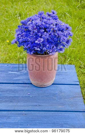 Beautiful Bouquet Wild Cornflower In Vase On Old Blue Table