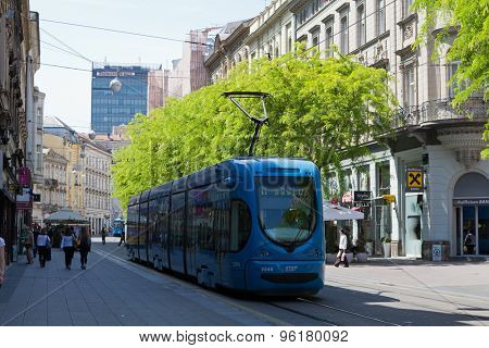 ZAGREB, CROATIA - MAY 13, 2015: Tram and people passing by through Jurisiceva street