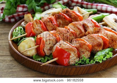 Chicken kebab with bell pepper on wooden skewers