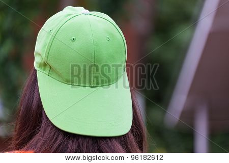 One Girl With Hair Color Ware Green Cap