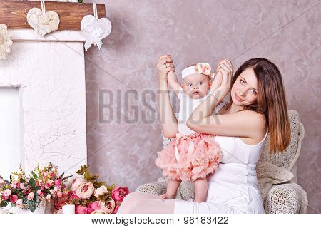 Mother Playing With Her Little Daughter.