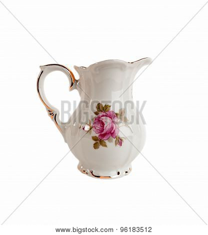 Ceramic milk or creamer pitcher with a pattern of roses and gold in classic style
