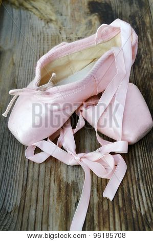 Old worn pink pointe shoes for ballet