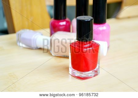 A bottle of red nail polish closeup