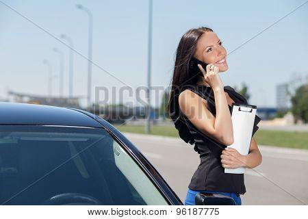 Cheerful young woman is communicating on the phone