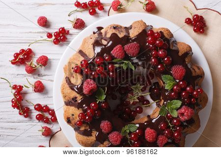 Berry Sponge Cake With Chocolate On A Plate Closeup. Horizontal Top View