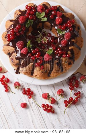 Sponge Cake With Fresh Berries And Chocolate Closeup. Vertical Top View