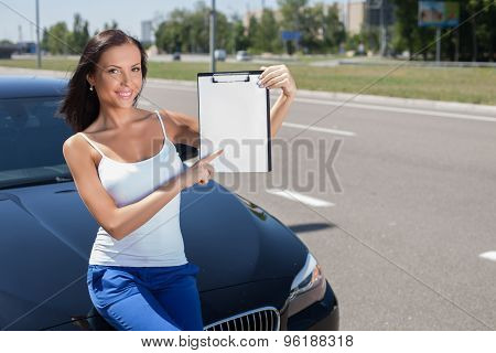 Cheerful young woman wants to by a modern transport