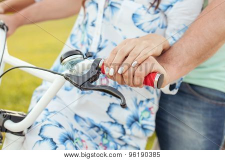 Young boyfriend and girlfriend are cycling with pleasure