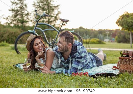 Beautiful woman and attractive man have a picnic