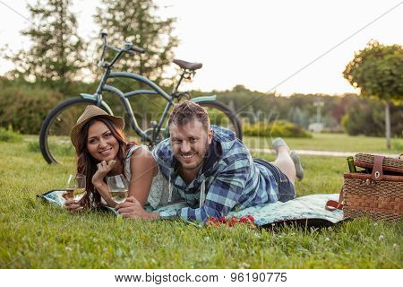 Cheerful young couple is relaxing in the nature