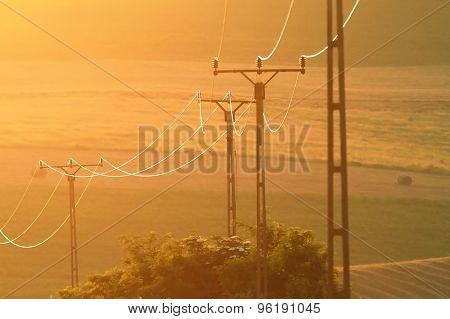 Electric Pillars At Sunset