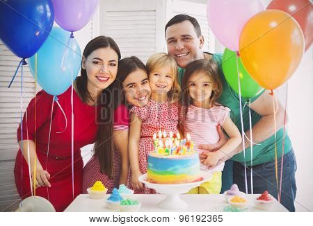Portrait Of A Family Celebrating Birthday Of Their Little Daughter