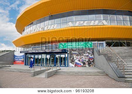 VLADIVOSTOK, RUSSIA - 15 July, 2015: Fetisov Arena Sports Palace before games at the Davis Cup between Russia and Spain, 17-19 July 2015. On the facade of hanging banners on the game of tennis.