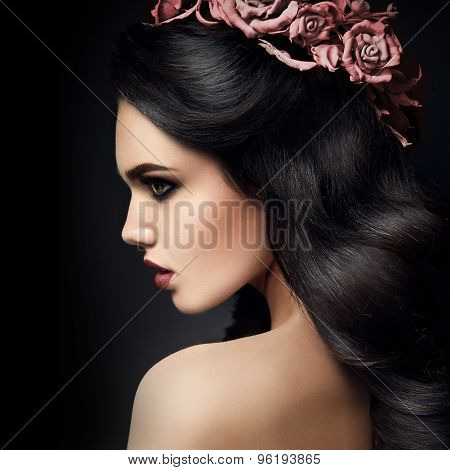 Beauty Fashion Model Girl Portrait with Roses Hairstyle. Red Lips.