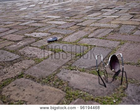 Broken sunglasses on the street