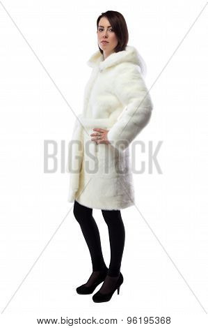 Photo of woman in white fur coat, half turned