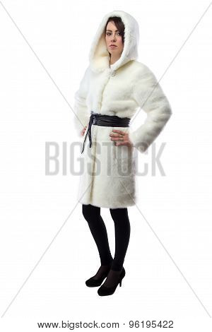 Woman in white fur coat with hood, half turned
