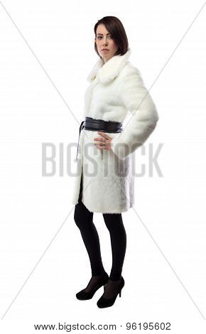 Image of young woman in white coat, half turned