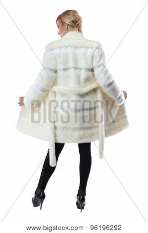 Blonde in white unbuttoned coat, from back