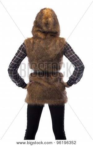 Image of blonde in brown fur jacket, from back